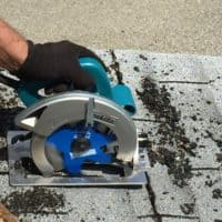 BigBlue Demolition Blade cutting through two layers of shingles and nails